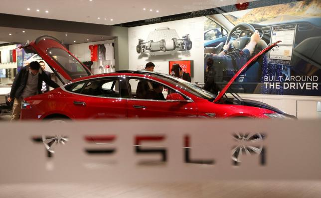 Tesla removes 'self-driving' from China website after Beijing crash