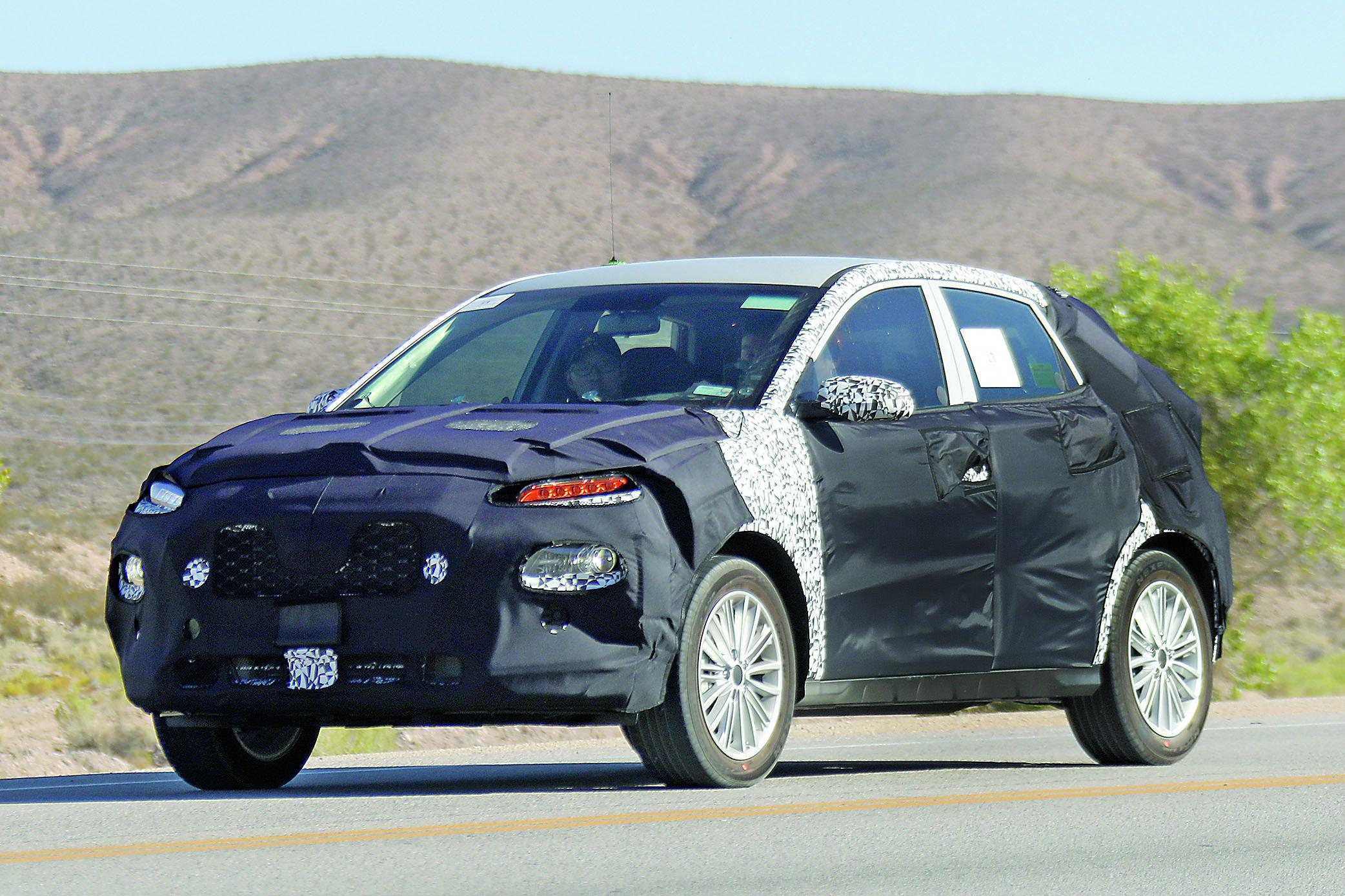 Kia's upcoming crossover shown in these spy photos will slot below the Sportage.