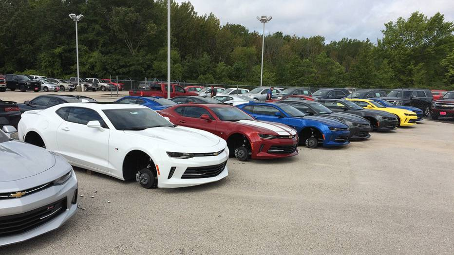 Police say wheels were stolen from 48 cars at a Texas dealership.
