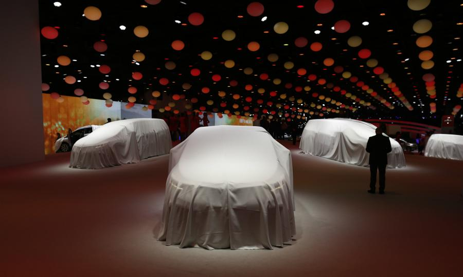 Cars are pictured ahead of their unveiling at the Paris auto show in 2014