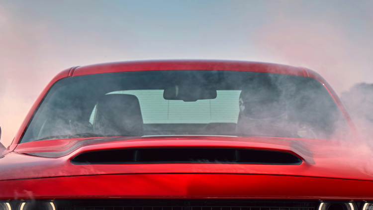 The Dodge Demon's massive hood scoop sucks air like a jet intake