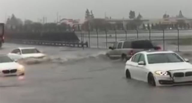 Watch An Audi Sail Past Two Stranded BMWs On A Flooded Highway