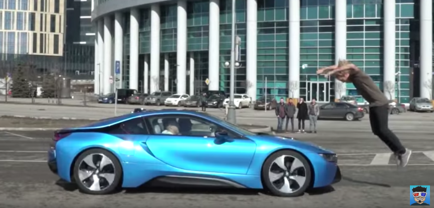 Stuntman jumps over moving BMW i8