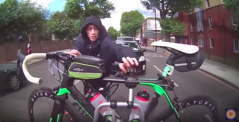 Watch persistent thief try to steal bike from moving car