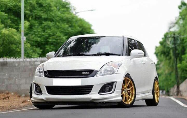Custom Maruti Swift with gold alloy rims
