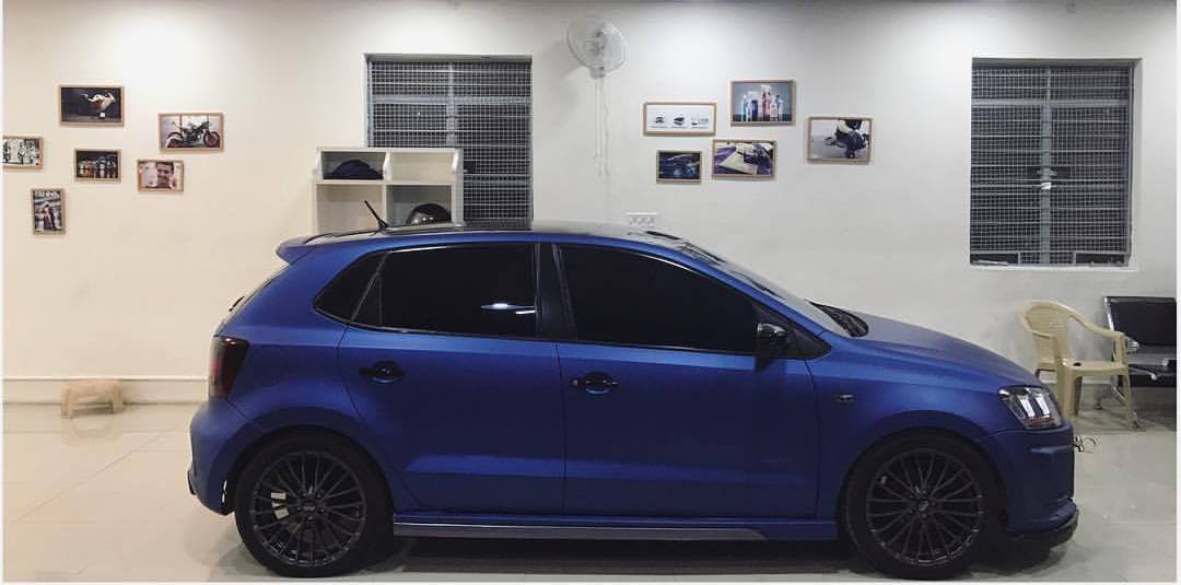 VW Polo with sports body kit and matte blue wrap