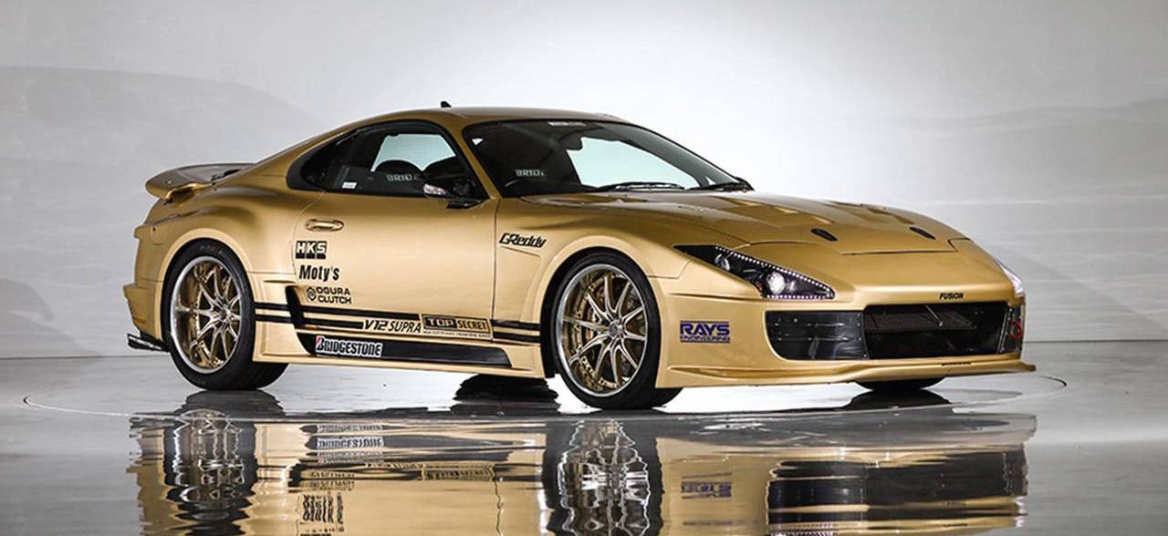 Go For Gold With This Mental 358 km/h V12 Toyota Supra