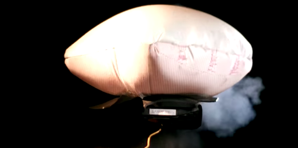 Watch an airbag inflator (without the bag) go off in slow motion