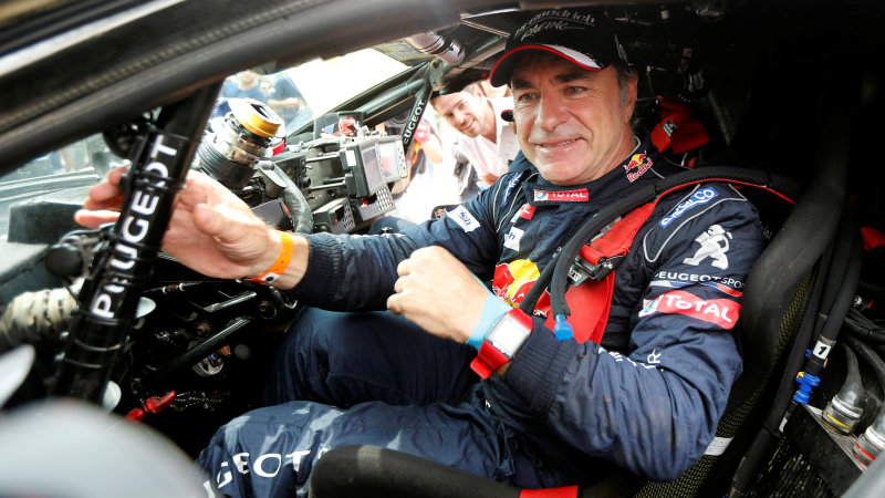 Carlos Sainz clinches Dakar victory for Peugeot