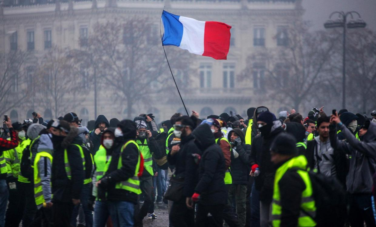 Macron makes U-turn on fuel tax after 'yellow vest' protests