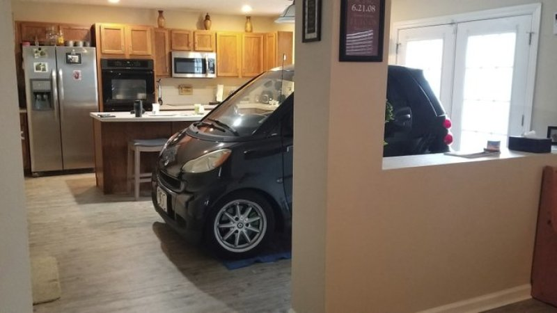 Florida man parks Smart car in kitchen to save it from Hurricane Dorian