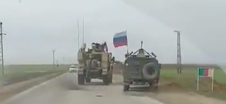 American Armored Truck Pushes Russian Military Vehicle Off the Road in Syria