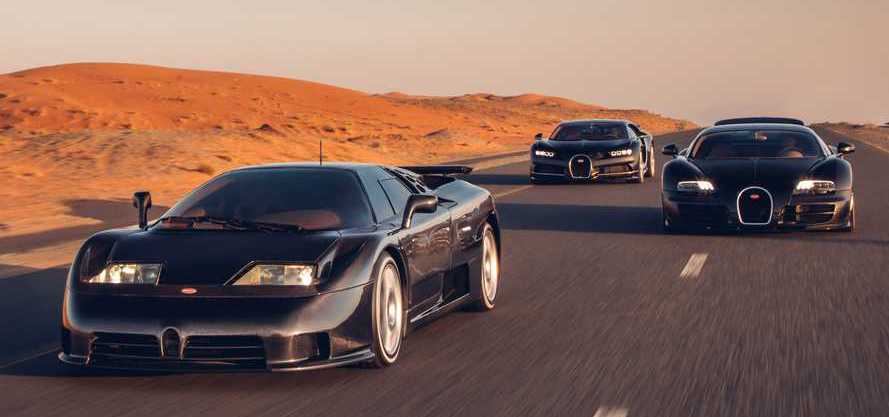 Bugatti's three modern supercars – from the 1990s, 2000s, and 2010s – smile for the camera.