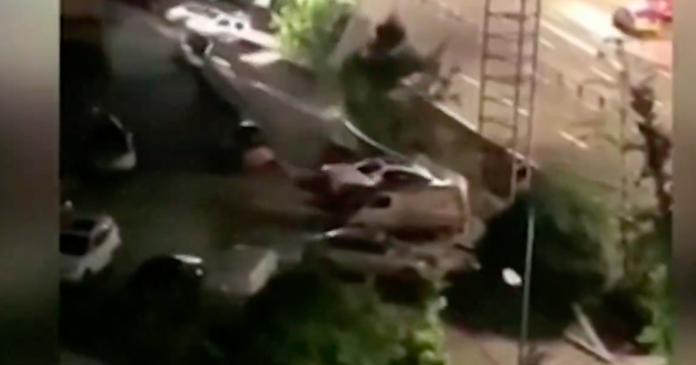 Watch Massive Sinkhole In China Devour 21 Cars