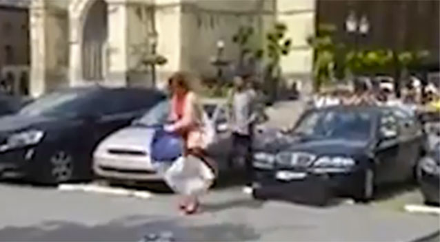 Woman Smashes Ex-Boyfriend's Car With His Guitar
