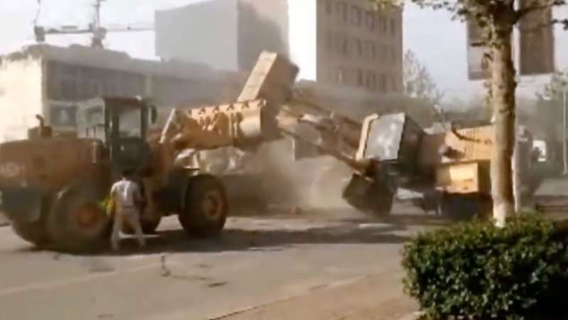 Chinese Heavy Equipment Gladiators Fight On The Street