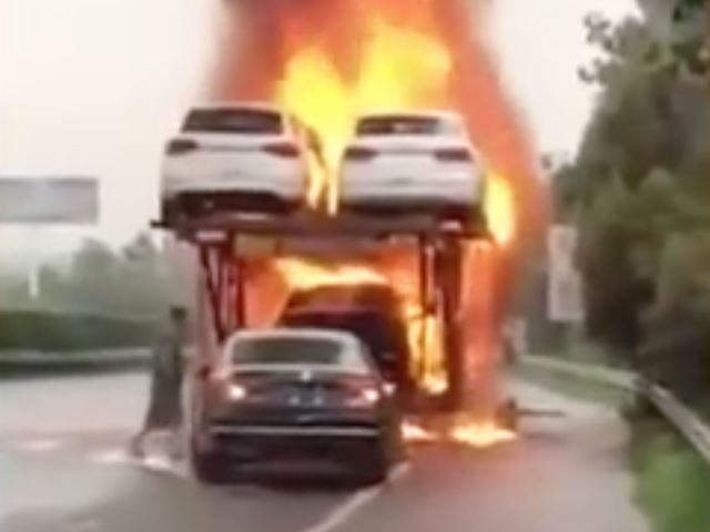 Would You Risk Your Life To Save A Car From A Burning Transport Truck?