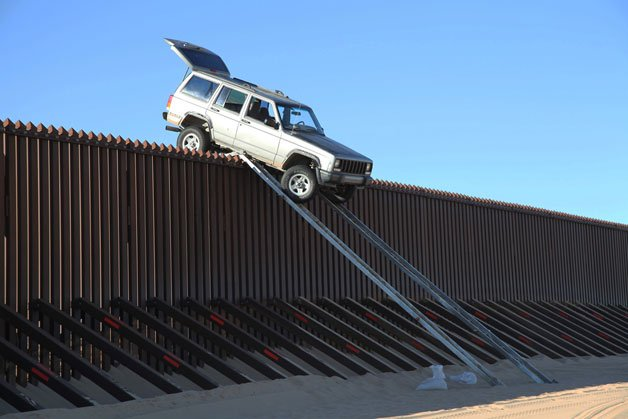 Jeep Cherokee Left Teetering on Border Fence after Failed Crossing Attempt