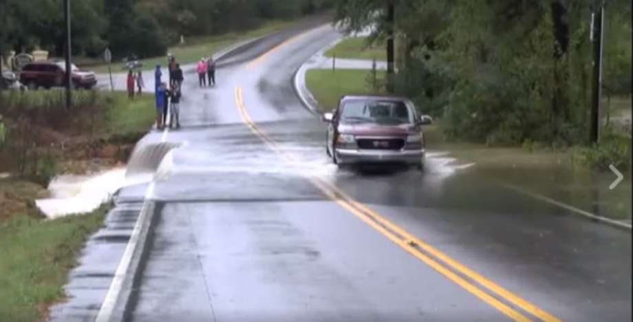 This Is Why You Should Never Drive Onto A Flooded Road