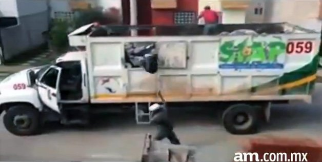 Watch These Workers Ghost-Ride the Garbage Truck With Purpose
