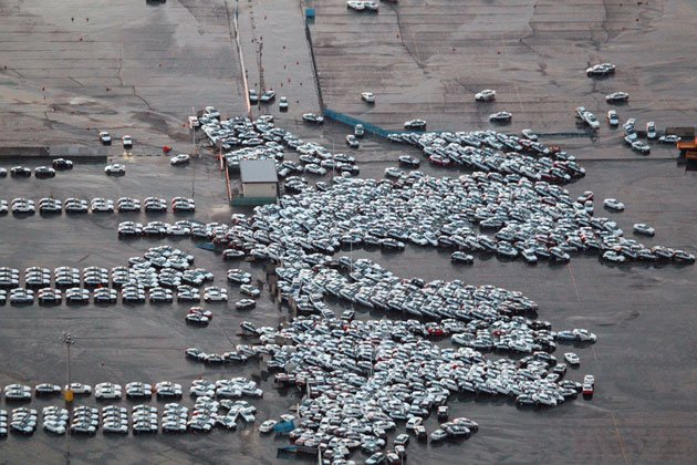 Tsunami in Japan destroys mass of cars ready for shipping