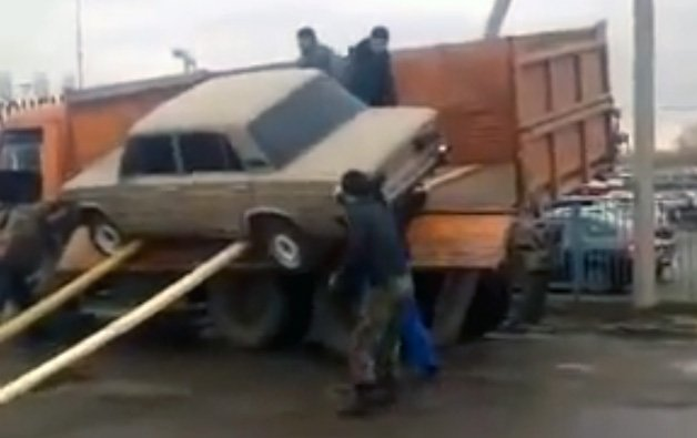 Worst Car Unloading Attempt Ever is Quick and Painful