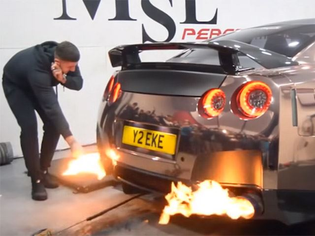 Watch This Idiot Light A Cigarette on a GT-R's Exhaust Flame