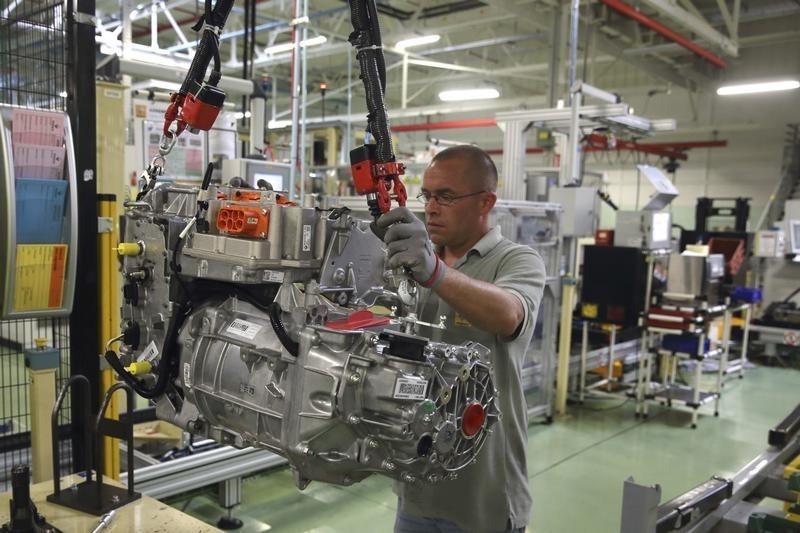 A employee handles the new R240 electric engine by French carmaker Renault for their Zoe model autom