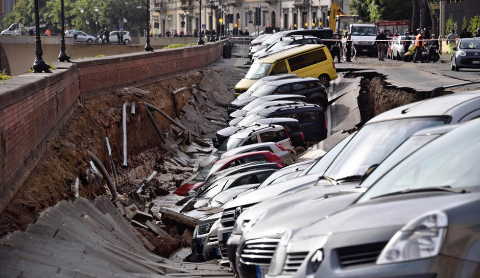 Watch Dozens Of Cars Swallowed By Sinkhole In Italy