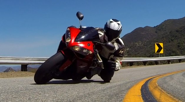 Watch this Sportbike Rider Snatch Up a GoPro at Maximum Lean