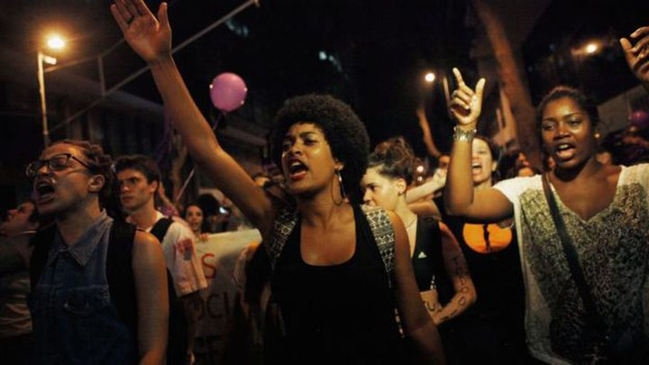 Protesters in Rio, demanding reforms including better protection from male violence ..