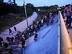 Refugees Break Through Police Lines and March on Hungary Highway