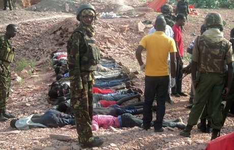 Troops standing over the victims of a massacre by Shabab militants in northern Kenya