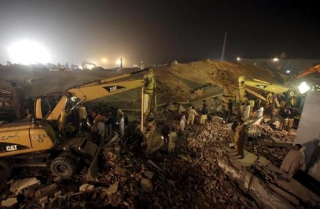 Rescue workers search for survivors after a factory collapsed near the eastern city of Lahore