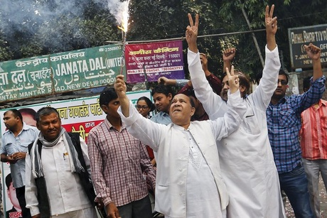 Members of the opposition alliance cheering Sunday outside a party office in New Delhi