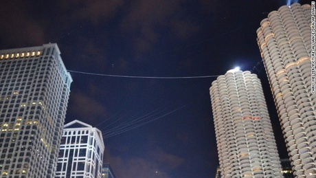 Aerialist Nik Wallenda traversed this wire Sunday above downtown Chicago.