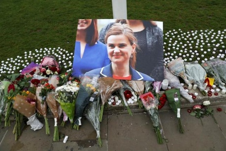 Tributes and candles left for murdered Labour Member of Parliament Jo Cox are seen in Parliament...