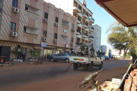 Security forces drive near the Radisson hotel in Bamako, Mali, November 20, 2015