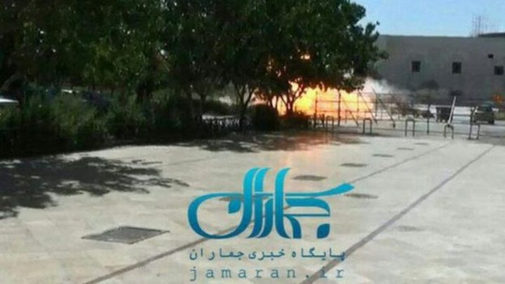 This image, posted by Fars News, shows an explosion taking place outside the mausoleum