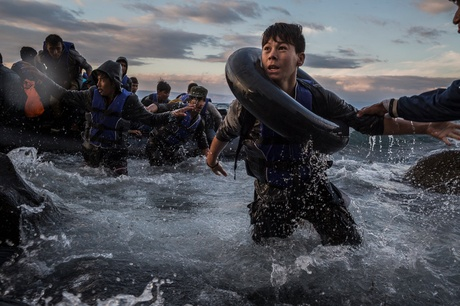 Migrants from Turkey landing on Lesbos in October after battling rough seas