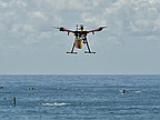 A drone has rescued two people from rough seas off the coast of Australia