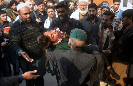 Taliban gunmen attacked a military school in Pakistan, killing at least 100, mostly children.