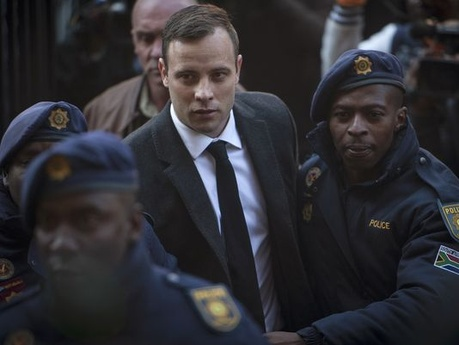 Oscar Pistorius arrives at court Wednesday in Pretoria.
