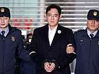 Samsung Group chief charged with bribery, corporate nerve center dismantled