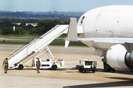 Zimbabwean soldiers patrol the seized cargo jet at Harare International Airport on Monday...