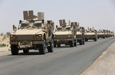 Military vehicles carrying Gulf Arab soldiers arrive at Yemen's northern province of Marib