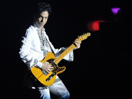 Prince performs during his headlining set at Coachella Valley Music and Arts Festival..