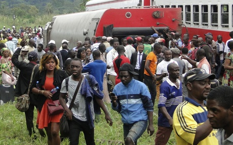 Passenger escape the site of a train derailment in Eseka on October 21, 2016.