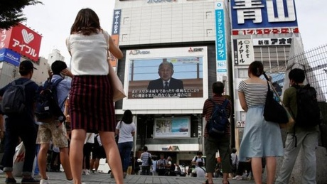 The emperor's historic address was watched on big screens outdoors in Tokyo