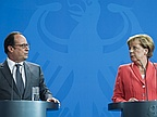 Angela Merkel and Francois Hollande Shrug Off Market Crash